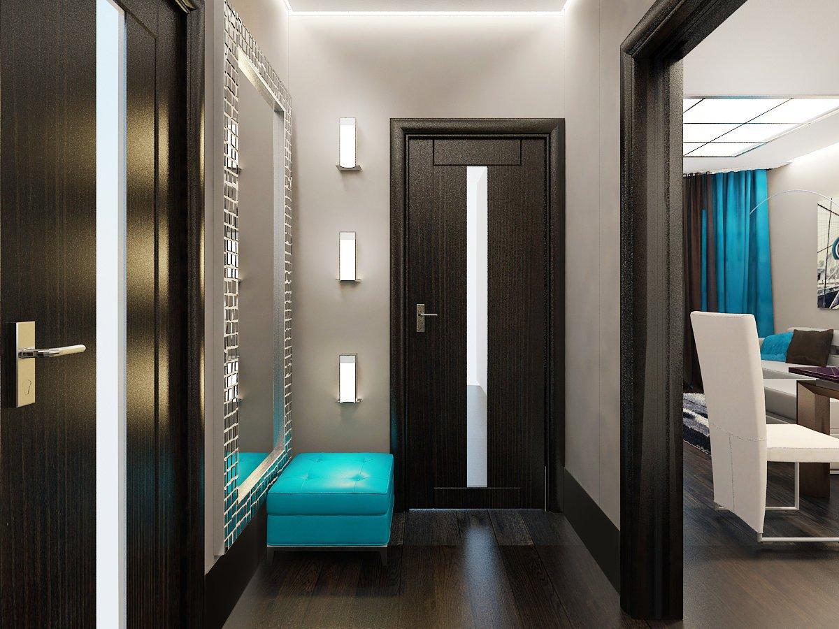 Темные двери в прихожей квартиры со светлым интерьером