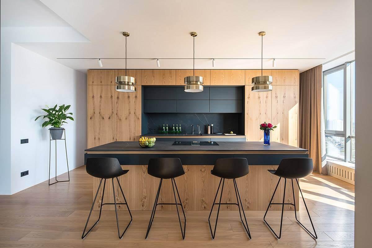 Кухонный остров является не только дополнительным местом для приготовления еды, но и столом для быстрого перекуса или семейного завтрака