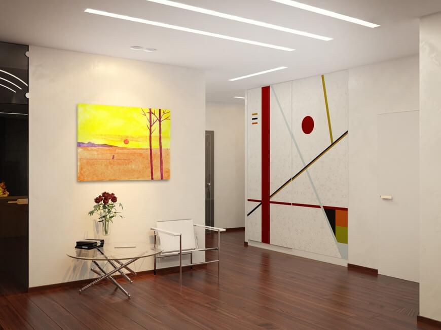 Абстрактная крупная живопись на акцентной стене придает живости и яркости холодному оттенку комнаты