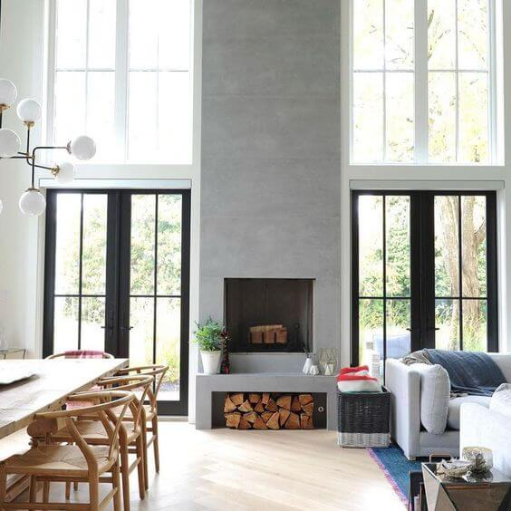 Бетонный камин будет оригинальный дизайн решением для пространств, нуждающихся в стилистическом обновлении.