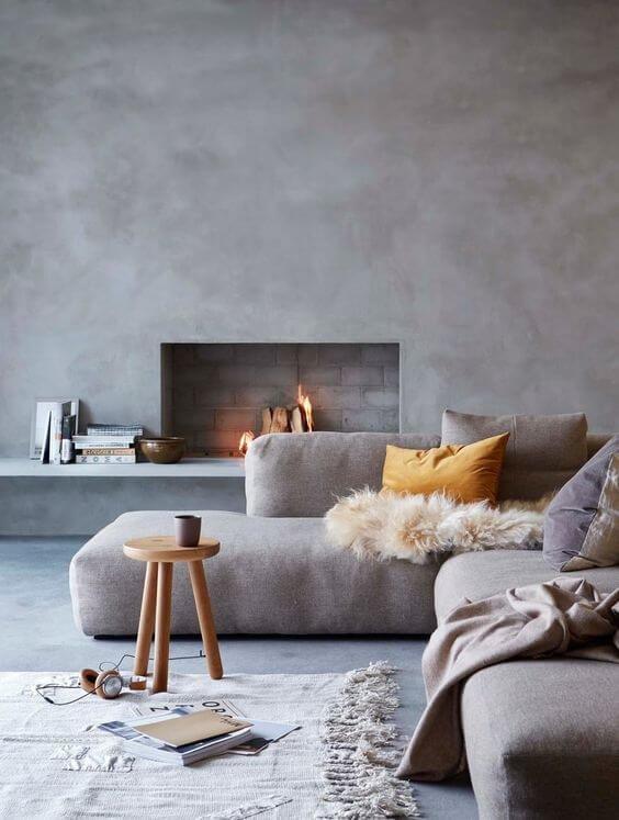 Угловой диван в сочетании со стилистикой скандинавского шика станут отличным решение для небольшой гостиной.